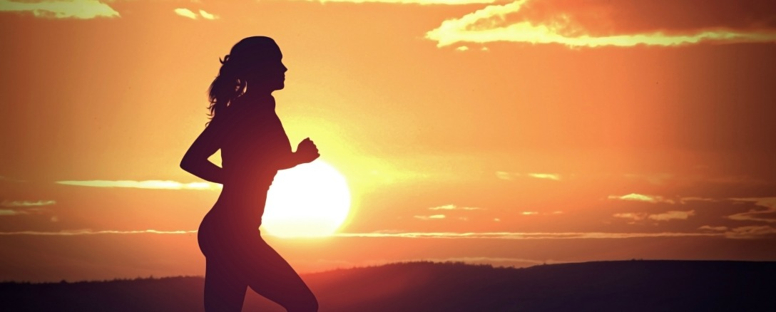 Young Woman Jogging at Sunset - Fitness and Health